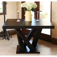 You'll love the modern elegance of this sleek Abbyson Living Cosmo espresso wood square dining table. Perfect for fans of abstract art and minimalism, this wooden square dining table features an interesting leg design.