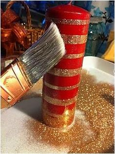 Here is another decorating idea for your holiday parties. Just wrap double sided tape around a large candle, sprinkle glitter, and it creates an elegant looking centerpiece.