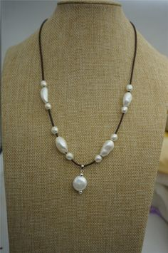 A personal favorite from my Etsy shop https://www.etsy.com/listing/228011121/long-freshwater-pearl-and-leather-lariat