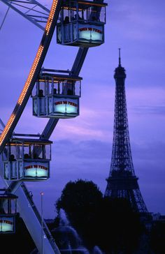 The Paris Ferris Wheel and Eiffel Tower ~ by Lonely Planet Images