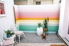 DIY Rainbow Fence - at home with Ashley - - DIY Rainbow Fence. How to build a horizontal privacy fence on a budget. This project is cheap and easy- perfect for a backyard or garden.