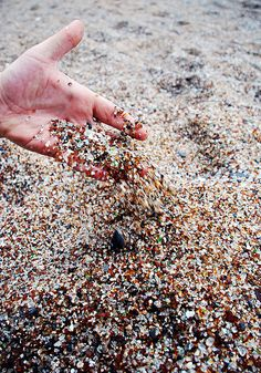 sea glass beach. Port Allen, Hawaii- there is a beach on Aruba, where the glass is fine, and as the waves wash it ashore, it looks like nature has given a beautiful necklace to the beach