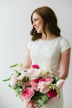 Bride's Lovely Bouquet Showcasing: Pink & Pastel Pink Peonies, White Anemones, Snapdragons, Greenery + Foliage