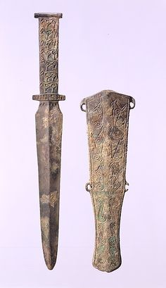 Short Sword and Sheath with Animal Motifs  Date: 7th–6th century B.C. Culture: Northeast China Medium: Bronze Dimensions: Sword: L. 11 7/8 in. (30.2 cm) Sheath: L. 8 1/2 in. (21. 6 cm) Classification: Metalwork Credit Line: Gift of Mr. and Mrs. Eugene V. Thaw, 2002 Accession Number: 2002.201.5a, b Swords And Daggers, Knives And Swords, Chinese Armor, Arm Armor, Fantasy Weapons, Ancient Artifacts, Bronze Age, Archaeology, Metal Working