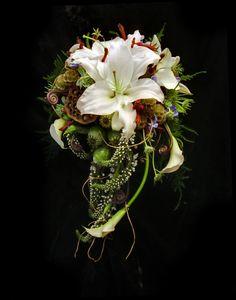 Cascade style bouquet eaturing white lilies and white calla lilies Flowers by April's Garden durangoflorist.com/ https://www.facebook.com/aprilsgiftgarden