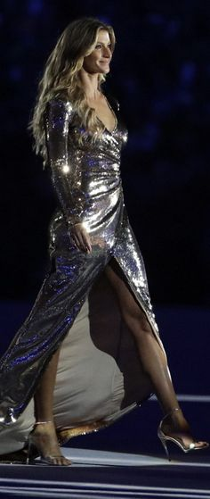 Gisele Bundchen in Alexandre Herchcovitch struts her stuff (for the last time!) for the Olympic Opening Ceremonies. #Rio2016