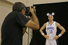 Orlando Magic center Marcin Gortat poses with Mickey Mouse ears on his head during Orlando Magic Media Day. Mickey Mouse Ears, Orlando Magic, Tank Man, September, Poses, News, Mens Tops, How To Wear, Figure Poses