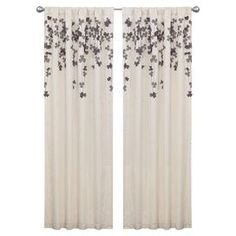Curtain panel with cascading flower motif in ivory and purple.  Product: 1 Curtain panelConstruction Material: 100% PolyesterColor: Ivory and purpleFeatures: Rod pocket slides onto curtain rod for installationDimensions: 84 H x 42 WNote: Curtain rod not includedCleaning and Care: Dry clean only