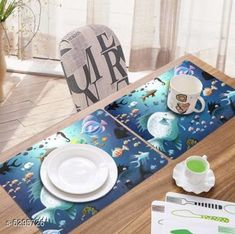 Table Runner Classy Dining Table Place Mats  Material: PVC Pack: Pack Of 6 Pattern: Printed length: 44 cm breadth: 29 cm height: 1 cm Country of Origin: India Sizes Available: Free Size   Catalog Rating: ★4.1 (2678)  Catalog Name: Classy Dining Table Place Mats CatalogID_999879 C129-SC1127 Code: 981-6295726-393