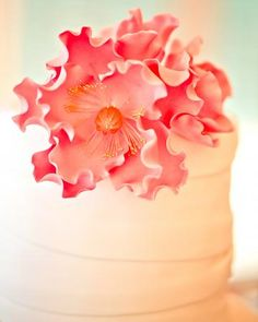 A sugar peony cake topper that matched the bride's bouquet