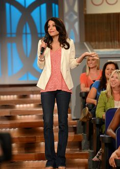 Nude peep-toe heel - B by Brian Atwood  Flared blue jean - J Brand  Pink beaded tank -- Joie  White blazer -- Truth and Pride