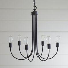 Shop Oakton Bronze Chandelier.  Six arms sweep a fresh take on the classic chandelier.   Arching a clean, linear silhouette, Oakton features six exposed bulbs and warm antique bronze finish.