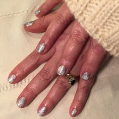 CND shellac silver chrome with lecente glitter and snowfkake stamping.
