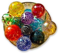 blown glass balls- I just bought 5 more 4 inch balls like these today! I hang them in my kitchen window!
