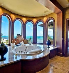 I would never want to get out of that tub! Love the windows and lighting
