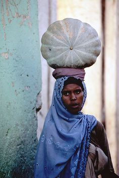 Harar, Ethiopia, Africa - wow, that looks like a truly amazing squash on her head.