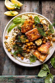 This Crispy Lemon Feta with Spiced Chickpeas and Basil Orzo is an easy meatless meal for any night of the week.a touch indulgent, but yet healthy too! Feta, Vegetarian Recipes, Cooking Recipes, Healthy Recipes, Healthy Desserts, Half Baked Harvest, Vegetable Dishes, Dinner Recipes, Orzo Recipes