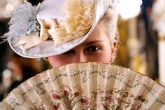 """Another shot of a """"dinner plate"""" hat from the Marie Antoinette movie - looks like a 3/4 scale fascinator, perched forward on the head...."""