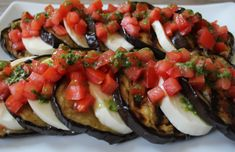 Grilled Eggplant with Fresh Mozzarella, Tomatoes and Basil Vinaigrette. The perfect summer appetizer, side dish or light meal for entertaining!