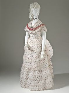 Woman's Polonaise Dress England, circa 1875 Costumes Cotton plain weave with wool of discontinuous supplemental weft, silk satin ribbon, and machine lace 1870s Fashion, Edwardian Fashion, Vintage Fashion, French Fashion, Gothic Fashion, Vintage Couture, Steampunk Fashion, Vintage Outfits, Vintage Dresses