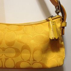 """Coach monogram baguette Summery canary yellow Coach baguette in signature canvas with leather accents, silver hardware, and an adjustable shoulder strap. Gently used but still in beautiful condition. Bottom corners show minimal sign of wear. Inside is clean. Measures approximately 10""""w x 5""""h x 3""""d Coach Bags Shoulder Bags"""