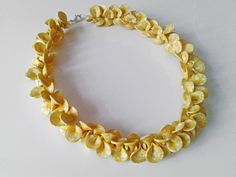 handmade polymer clay necklace with yellow petals