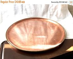 VINTAGE Copper large Dish plate Round charger or tray with brass rope trim very heavy solid copper boho chic decor  Condition - Great condition. Measures 11 1/2 inches in diameter  Thanks for visiting! To receive our listings as they appear, click on the heart in the Favourite Shop box. Check out other vintage related items in this Etsy shop: StudioVintage https://www.etsy.com/shop/StudioVintage  Enjoy