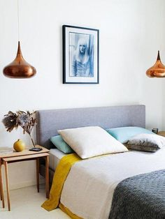 A Taste of Summer: Beautiful Australian Beach House -- Love this retro 70's color palette of bright mustard yellow, shining copper, slate gray, turquoise and white, in this sleek and minimalist midcentury modern bedroom.