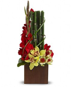 snake grass with red gladioli and green cymbidium orchids