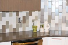 This was a successful solution to a busy non-pattern as there was over 60 square feet of tile in this backsplash.