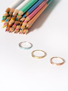The new Arc Band joins its colorful partner, the Enamel Arc Band, in 14kt yellow and rose gold. Wispy, hollow curves and the subtle irregularities of natural forms accent these non-traditional wedding bands.