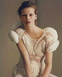 Sculptural Fashion - structured crochet blouse with three-dimensional sleeve & surface pattern detail