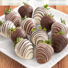 Our huge, sweet, farm fresh strawberries are dipped in real premium dark chocolate and rich, creamy white chocolate. Each berry is delicately hand dipped and decorated in our own kitchen for both culinary artistry and exquisitely decadent taste. Includes: 4 Real Dark Chocolate Dipped Strawberries with Milk Chocolate Drizzle,  4 Real Milk Chocolate Dipped Strawberries with White Chocolate Drizzle, 4 White Chocolate Dipped Strawberries with Dark Chocolate Drizzle