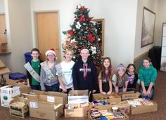 "These Girl Scouts hold an annual ""Santa Shop"" where they give unique gifts in exchange for food or monetary donations. This year they collected over 400 pounds of food for their local food shelf!"