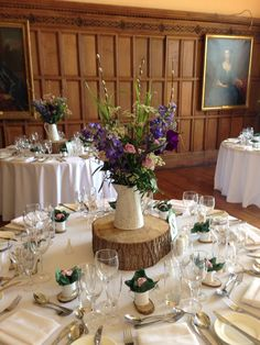 Country garden wedding flowers for table centres at Arley Hall. British flowers in a vintage style jug.