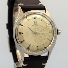 1951 Vintage Omega Ref. 2635-1 Stainless Steel watch with Original Silver Dial with Applied Steel Breguet Arabic 3, 6, 9, and 12 and Elongated Arrow Markers. Triple Signed. Swiss Case Case Original, O