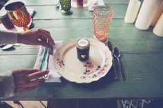 Mismatched plates, vintage glasses, fabric napkins, homemade jam favors