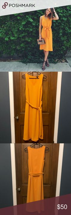 Trapeze Tie-Front Midi Dress Arizona Orange 2 Absolutely Beautiful Like New Midi Dress! This one is an instant classic. Gorgeous orange/yellow hue with a v-neck opening and tie waste. Hits mid-calf and can be dressed up or down for endless spring and summer fashion! Don't let this one pass you by! Ann Taylor Dresses Midi