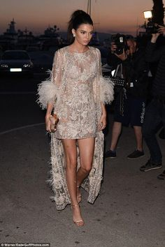 Kendall Jenner wearing Elie Saab Couture Spring 2015, Chopard Flower Earrings, Jimmy Choo Minny Sandals and Charlotte Olympia Gloria Clutch