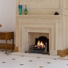 A stunning Georgian fireplace design, hand carved using natural stone by Pinckney Green Fireplaces. Shown in Natural Bath stone Georgian Fireplaces, Natural Stone Fireplaces, Stone Fireplace Designs, Fireplace Surrounds, Fireplace Ideas, Edwardian Architecture, Fire Basket, Granite Worktops, Multi Fuel Stove
