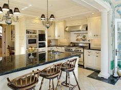 Cook in style. A pot filler is mounted over your stove & four appliance garages are provided. A butler's pantry adjoins
