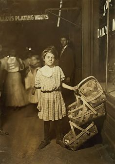 """Nearly Sold Out! """"Basket ! Five Cents Each!"""" Antoinette Siminger, 12 years old, 4219 Glenway Ave., Price Hill, Sixth St., Market, Cincinnati. 10 P.M. Had been selling since morning. Location: Cincinnati, Ohio. 1908"""