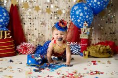 Wonder Woman ONEder First Birthday Photo Shoot. | first birthday | cake smash | photo | theme | ideas | messy | one | nj photographer | 1st | one | unique | baby | contemporary | vibrant | colorful | fun | red | white | blue | gold