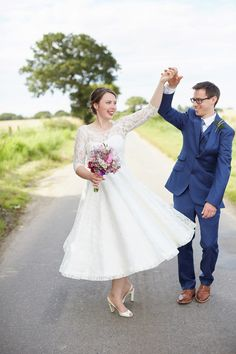 A fabulous 1950's Fur Coat No Knickers dress for a flower-filled Norfolk countryside wedding. Images by Fuller Photography.