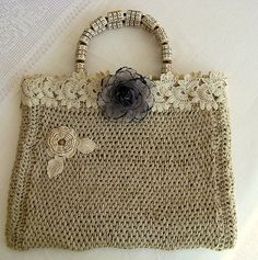 I love, love how this purse combines Tunisian Crochet in some sort of rope or jute with lace thread crochet.!