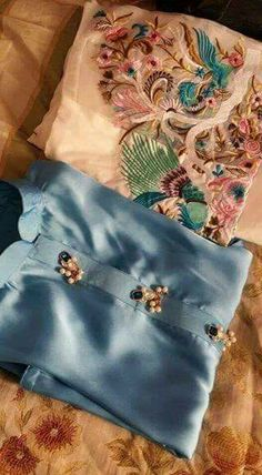 Beautiful sea green Kurti with ivory slim pants with embroidered hem