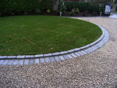 Gravel driveways can be very elegant when edged nicely