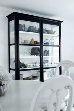 Cabinet. black outside, white inside
