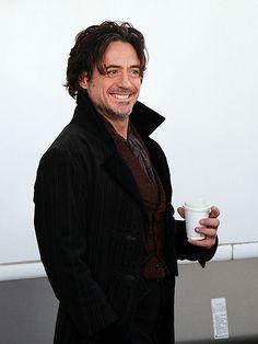 Because Sherlock Holmes (Robert Downey Jr.) needs his coffee before work.
