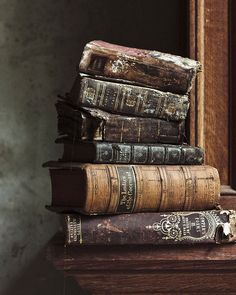 Stack of antique books ready to be made into   sketchbooks. Make residual income online while creating masterpieces. www.workwithbrandy.com